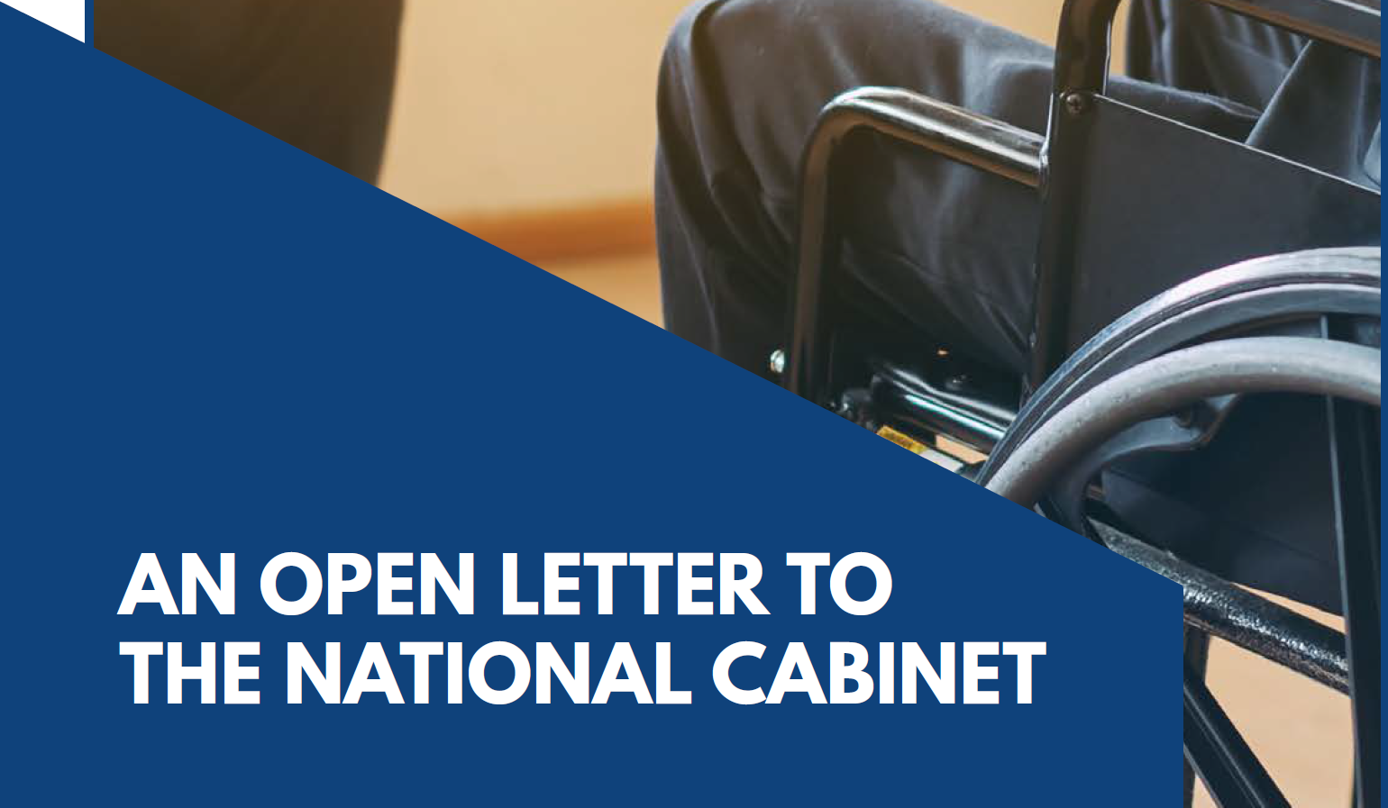An Open Letter to the National Cabinet - image - background is a wheelchair user sitting in an office meeting